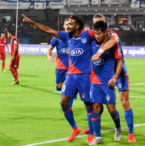 FIRST STRIKE: Bengaluru FC players celebrate their first goal against NorthEast United FC at the Sree Kanteerava Stadium on Wednesday. DH PHOTO/ B H SHIVAKUMAR