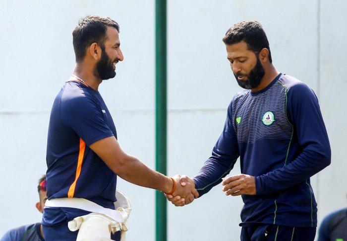 RUN-MACHINES: Saurashtra's Cheteshwar Pujara and Vidarbha's Wasim Jaffer greet each other on the eve of their Ranji Trophy final at the VCA Stadium in Nagpur. PTI