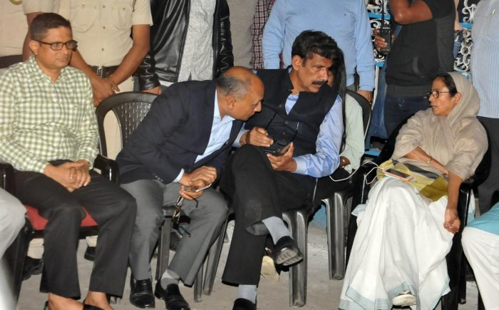 West Bengal Chief Minister Mamata Banerjee sitting on her 'Save the Constitution' dharna after CBI raided Kolkata Police Commissioner's residence in Kolkata on February 3. Kolkata Police Commissioner Rajeev Kumar (L) is also seen. PTI