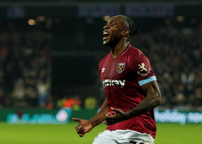 QUICK RESPONSE: West Ham's Michail Antonio celebrates after scoring the equaliser against Liverpool during their Premier League clash on Monday. Reuters