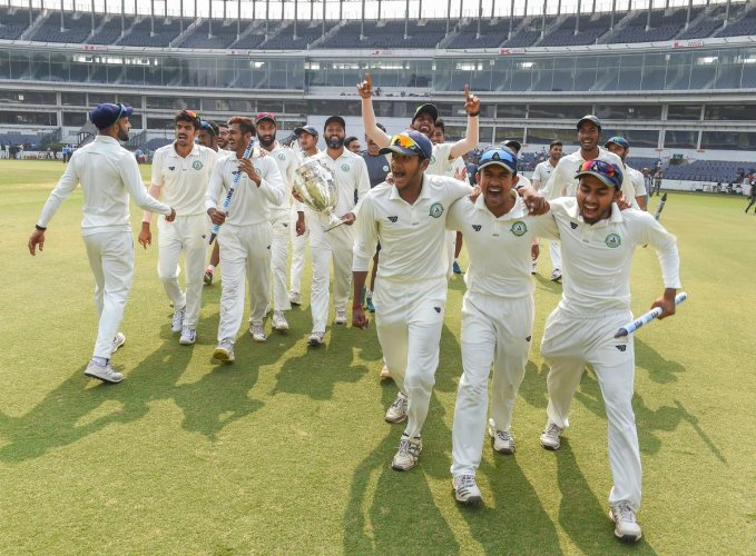 Vidarbha players celebrate after defeating Saurashtra in the Ranji Trophy final in Nagpur on Thursday. PTI
