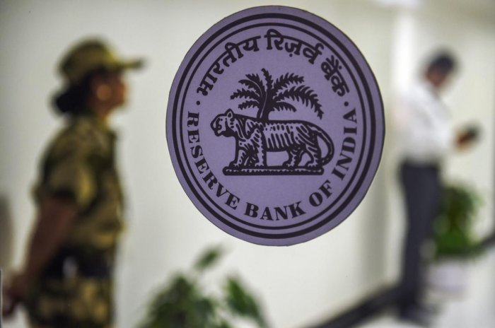 A security woman guards at the RBI headquarters during bi-monthly monetary policy review meeting, in Mumbai. PTI