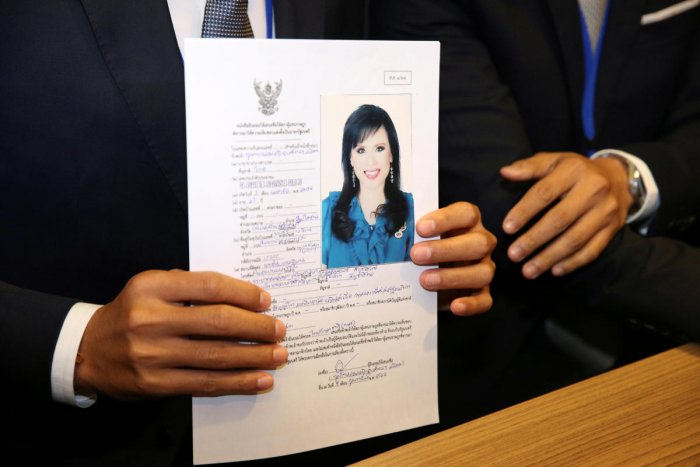 Thai Raksa Chart party leader Preechapol Pongpanich, holds up application of candidate for Prime Minister, Thailand's Princess Ubolratana Rajakanya Sirivadhana Barnavadi, at the election commission office in Bangkok, Thailand February 8, 2019. REUTERS