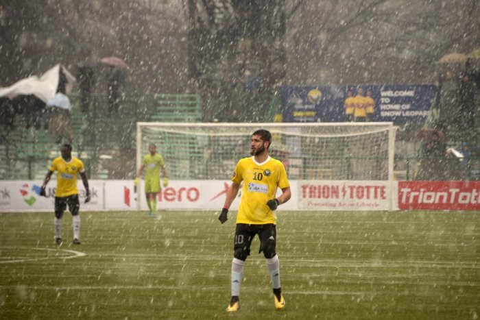 In this photo taken on February 6, 2019, Real Kashmir's Danish Farooq looks on amid snowfall during their I-League club football match against Gokulam Kerala FC at the Tourist Reception Centre football ground in Srinagar. - Real Kashmir is the first club