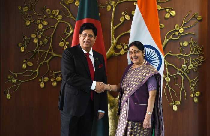 Foreign Minister Sushma Swaraj (R) shakes hands with her Bangladesh counterpart A K Abdul Momen (L) before a meeting at the Ministry of External Affairs in New Delhi on Friday. AFP