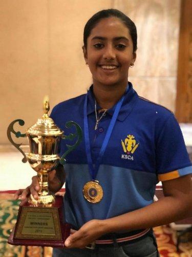 PROMISING: Karnataka's Roshini Kiran with the South Zone U-16 Championship trophy.