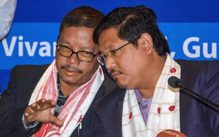 Meghalaya Chief Minister Conrad K Sangma and former Meghalaya chief minister Donkupar Roy attend the N E Region's Political Parties Convention on Citizenship Amendment Bill, in Guwahati, Tuesday, Jan. 29, 2019. (PTI Photo)
