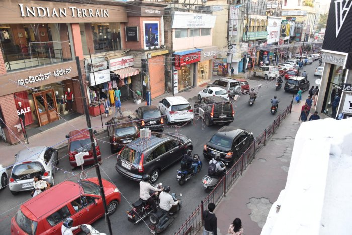 The plan to convert Commercial Street and Brigade Road as non-motorable streets and complete pedestrian roads is also expected to gather various reactions from citizens. Apart from this, the introduction of Commuter Card, a single card for both BMTC and Metro services is expected to make a seamless ticketing system for both modes of transportation. (DH file photo)