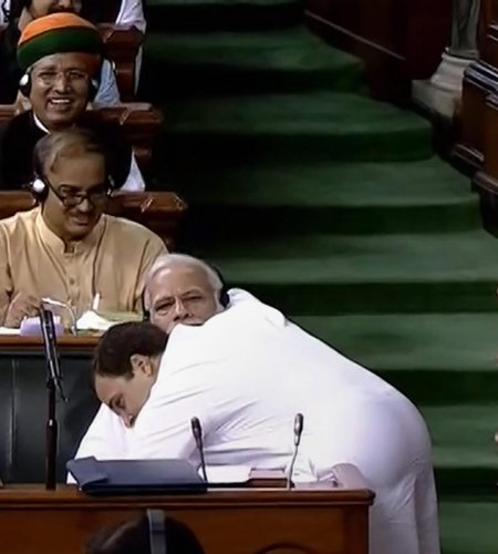 Congress President Rahul Gandhi hugs Prime Minister Narendra Modi after his speech in the Lok Sabha on 'no-confidence motion' during the Monsoon Session of Parliament, in New Delhi on July 20, 2018. PTI