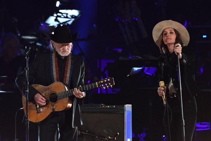 US musician Willie Nelson (L) and US singer-songwriter Brandi Carlile perform at the 2019 MusiCares Person Of The Year gala at the Los Angeles Convention Center in Los Angeles on February 8, 2019. - The 2019 MusiCares honor US singer-songwriter Dolly Part