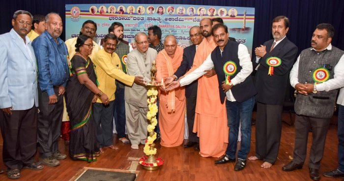 President of Bharatiya Dalit Sahitya Akademi S P Sumanakshar inaugurates the state-level seminar on 'Indian Constitution - Social Justice and Collective Responsibilities', in Mysuru on Saturday. Nidumamidi Mutt seer Veerabhadra Channamalla Swami, Urilinga