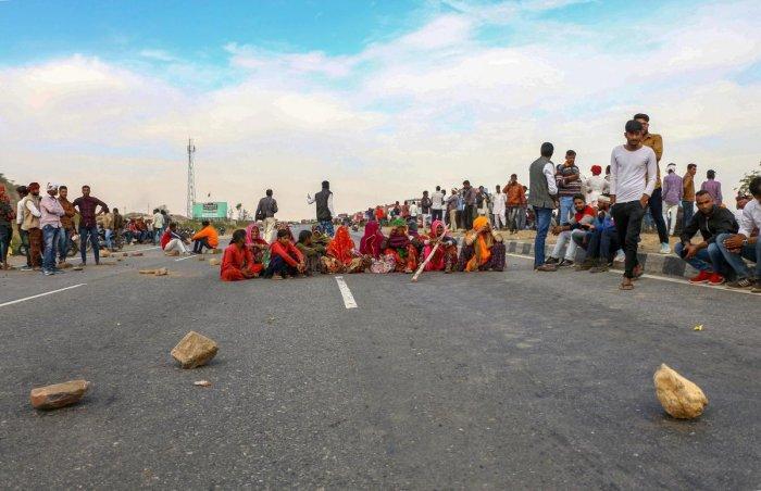 Gujjar community members block NH-58 near Ajmer on Sunday. (PTI)