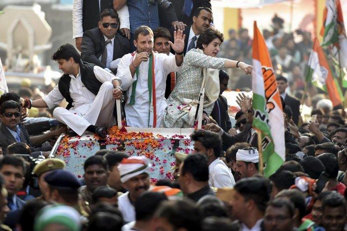 Congress President Rahul Gandhi with party general secretaries Priyanka Gandhi Vadra and Jyotiraditya Madhavrao Scindia during a roadshow, in Lucknow, Monday. (PTI Photo)
