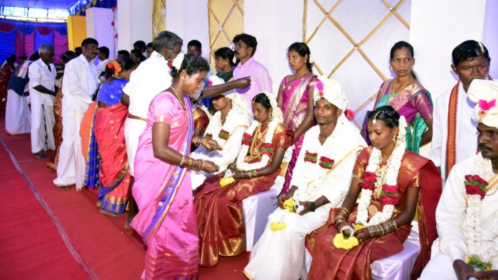 Family members wish the couples at the first Koraga mass marriage held at Kudmal Ranga Rao Community Hall at Kodikal in Mangaluru, on Sunday.