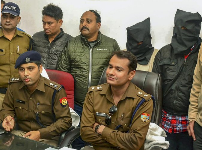Senior police officers address a press conference after the arrest of the accused persons who were involved in selling illicit liquor, in Roorkee, Sunday, Feb 10, 2019. (PTI Photo)