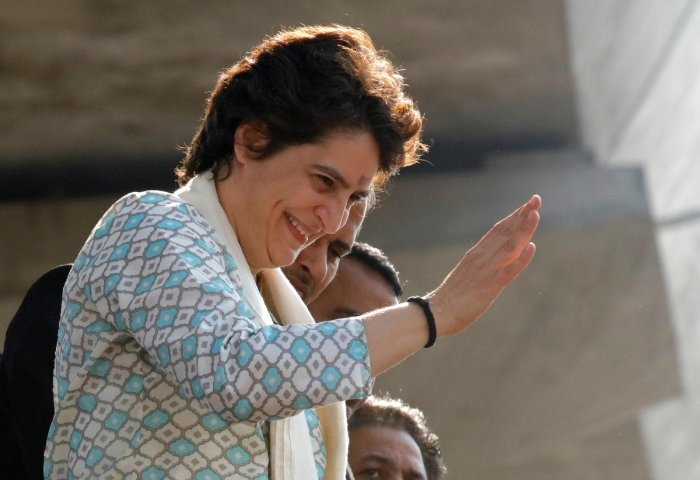 Congress general secretary Priyanka Gandhi Vadra waves to her supporters during a roadshow in Lucknow on Monday. REUTERS