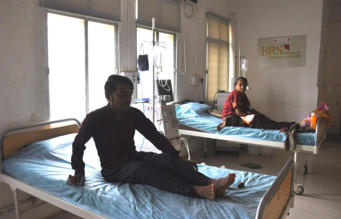 Due to power disruption patients at the 100-bed government hospital in Hosapete waiting for treatment on Monday. DH Photo
