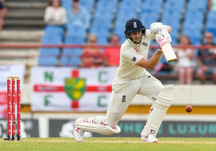STEPPING UP: England skipper Joe Root drives one to the fence en route his unbeaten 111 on the third day of the third Test against the West Indies in St Lucia on Monday. AFP
