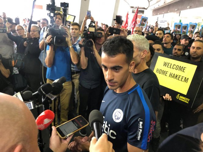 Hakeem al-Araibi, a refugee Bahraini footballer who was released from a Thai prison, talks to the media as he arrives at the airport in Melbourne, Australia February 12, 2019 in this picture obtained from social media. (Australian Council of Trade Unions/
