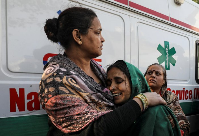 A woman cries as she cannot find her relative who was staying in a hotel where a fire broke out in New Delhi, India, February 12, 2019. REUTERS