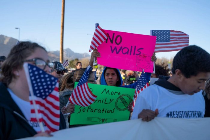 """Anti-Trump marchers gather for the """"March for Truth"""" in El Paso, Texas, on February 11, 2019. - The march took place at the same time as US President Donald Trump pushed his politically explosive crusade to wall off the Mexican border at a rally in El Pas"""