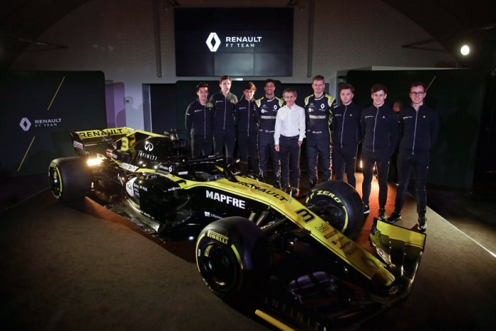 Former F1 champion Alain Prost (centre) is flanked by Renault F1 Team drivers Nico Hulkenberg (on his left) and Daniel Ricciardo and other team members during the 2019 car launch on Tuesday. AFP Photo