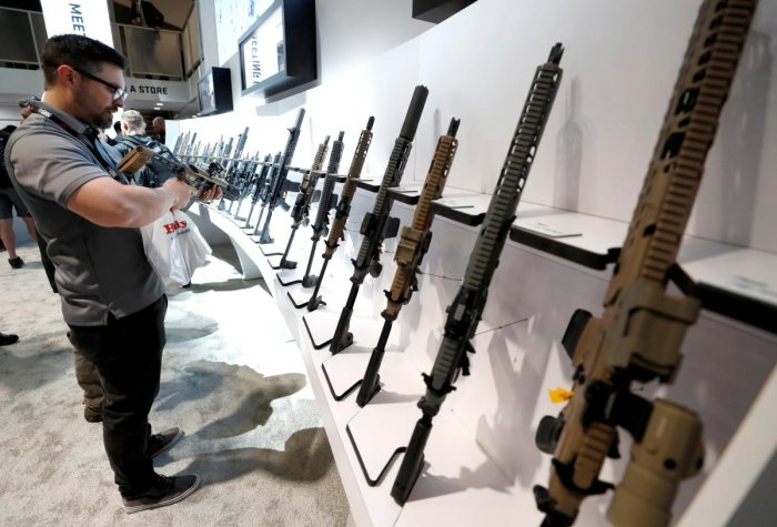 An attendee looks over a Sig Sauer semiautomatic rifle during the SHOT (Shooting, Hunting, Outdoor Trade) Show in Las Vegas. Reuters file photo for representation.