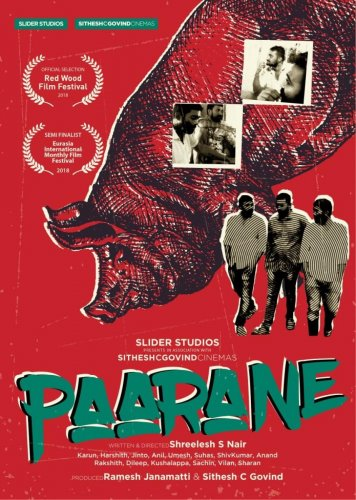 The original poster of the film Paarane.