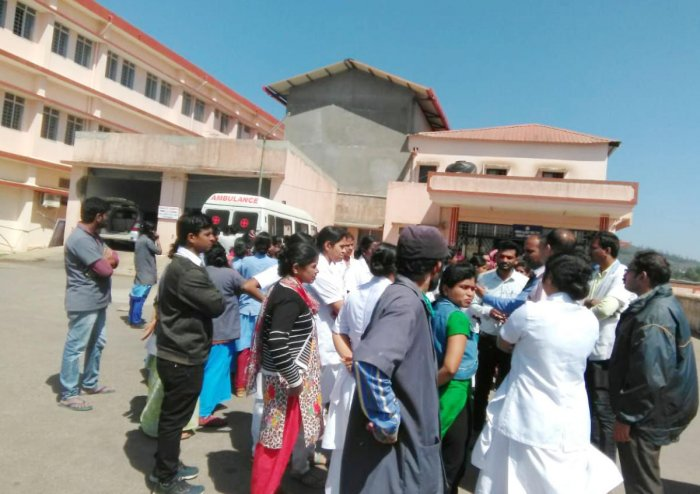 Contractual staff at the district hospital in Madikeri staged a protest on Tuesday.