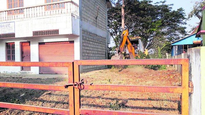Land being leveled for setting up Ayurveda and Unani treatment centres for the Kumbh Mela at T Narasipur, Mysuru district.
