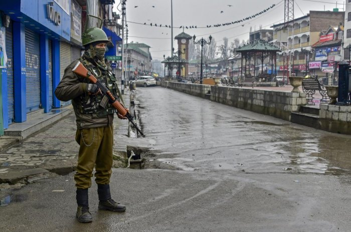 Srinagar: A security personnel stands guard at Lal Chowk during a two-day strike call given by separatist leaders to protest against the legal challenge to Article 35-A and Article 370 of the Constitution, which grant special privileges to Jammu and Kashm