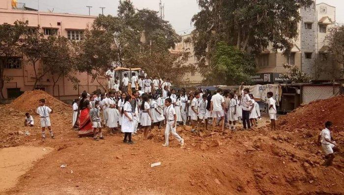 School children prevent the JCB from excavating the 40-year-old playground in Nandini Layout, Ramakrishna Nagar, near the Rajkumar Samadhi.