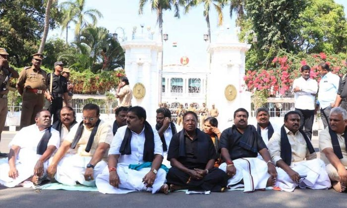 Puducherry Chief Minister V Narayanaswamy, his colleagues and party members sitting on a dharna outside the LG's official residence-cum-office. Photo: Facebook/CMPuducherry/