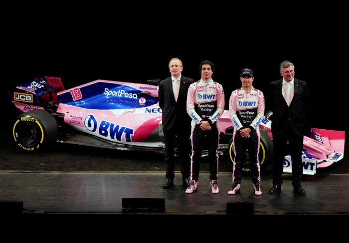 Racing Point F1 Team drivers Lance Stroll and Sergio Perez pose with team principal and CEO Otmar Szafnauer and technical director Andrew Green during the unveiling of the livery in Toronto on Wednesday. Picture credit: Reuters
