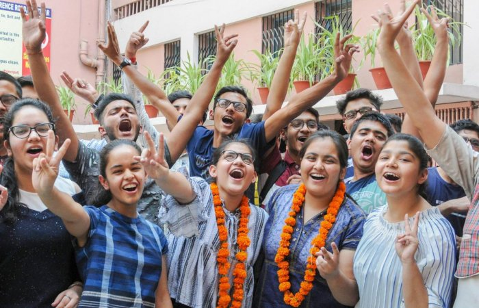 Students celebrate after the results of CBSE Class 10th were announced, in Amritsar on Tuesday. PTI