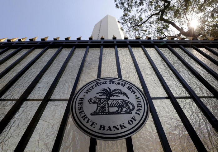 The Reserve Bank of India (RBI) seal is pictured on a gate outside the RBI headquarters in Mumbai. REUTERS
