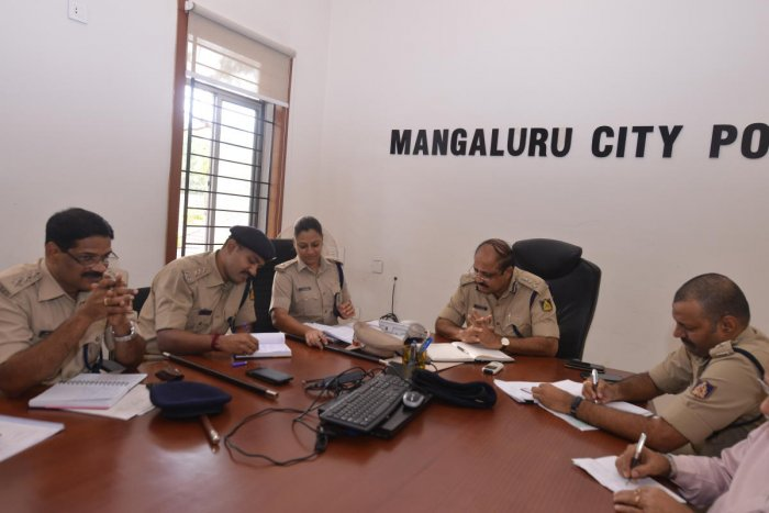 City Police Commissioner T R Suresh receives a call during a phone-in programme in Mangaluru.