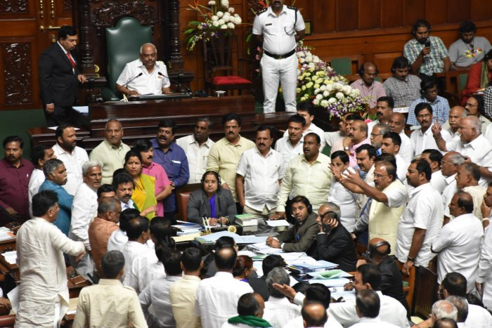 BJP legislators raise slogans during a protest in the well of the house against constitution of an SIT to probe the audio tapes on 'Operation Lotus', during the Budget Session of Assembly, Karnataka Chief Minister HD Kumaraswamy on Tuesday announced a com