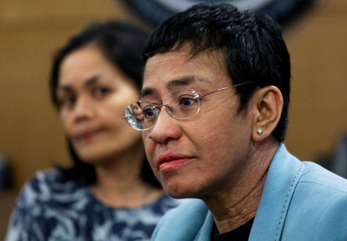 Rappler's CEO Maria Ressa waits inside the National Bureau of Investigation in Manila, Philippines. Reuters