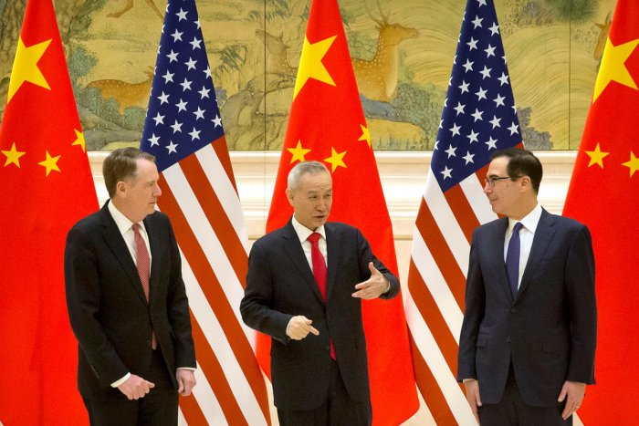 U.S. Trade Representative Robert Lighthizer, Chinese Vice Premier and lead trade negotiator Liu He, and U.S. Treasury Secretary Steven Mnuchin talk before the opening session of trade negotiations at the Diaoyutai State Guesthouse in Beijing. Reuters