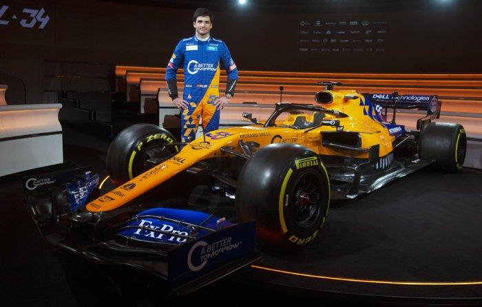 Carlos Sainz with the new McLaren MCL34 car. Picture credit: McLaren Racing