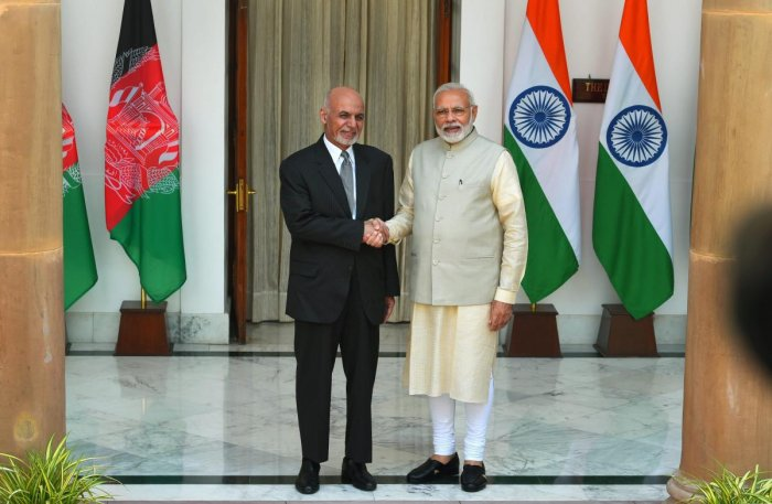 Prime Minister Narendra Modi and Afghanistan President Ashraf Ghani ahead of a meeting at Hyderabad House in New Delhi, Wednesday. (PTI Photo)