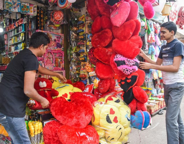 Youth buy greetings ahead of Valentine's Day at a store in Bengaluru.