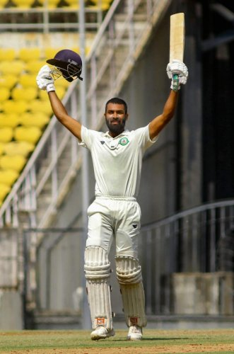 GUTSY: Vidarbha's Akshay Karnewar celebrates after reaching his century against Rest of India in the Irani Cup in Nagpur on Thursday. PTI