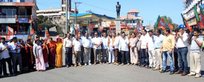 BJP workers protest at General Thimayya Circle in Madikeri on Thursday, opposing the attack on the house of Hassan MLA Preetham Gowda.