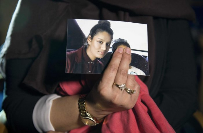 In this file photo taken on February 22, 2015, Renu Begum, eldest sister of missing British girl Shamima Begum, holds a picture of her sister while being interviewed by the media in central London. AFP