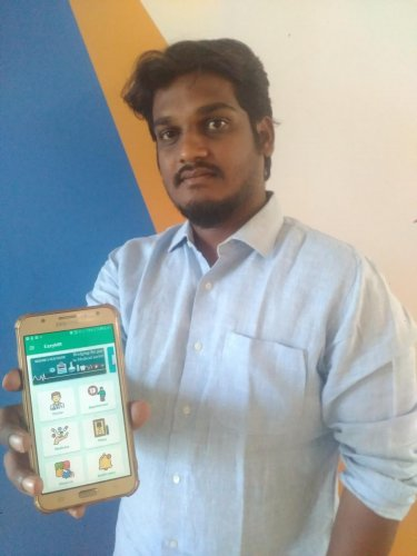 Sanjay Kangralkar displays 'EazyMR' mobile app developed by Coding Spider startup at KLETU in Hubballi.