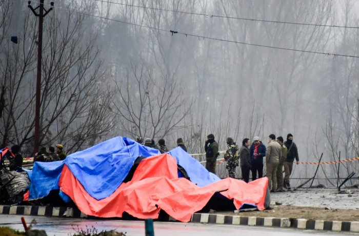 Security agencies inspect the site of suicide bomb attack at Lethpora area, in Pulwama district of south Kashmir. PTI