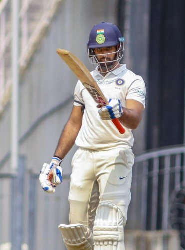 RUN MACHINE: Rest of India batsman Hanuma Vihari acknowledges his team-mates after reaching his century against Vidarbha during their Irani Cup match in Nagpur on Friday. PTI
