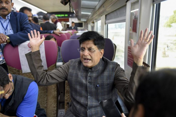 Railway Minister Piyush Goyal interacts with the media while travelling by the India's first semi-high speed train, the Vande Bharat Express, after it was flagged off by Prime Minister Narendra Modi from New Delhi Railway Station on Friday. (PTI Photo)